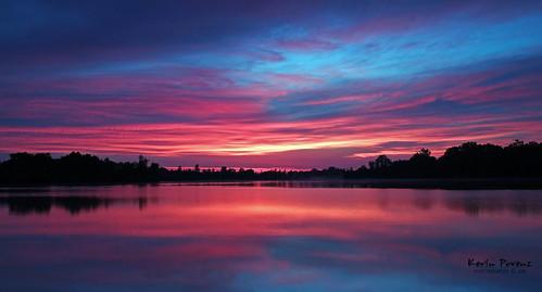 sky sun lake color tree clouds sunrise canon pond july redblue