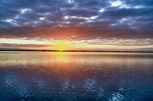 sun water clouds sunrise florida fl lakeland lakehancock nikkor1424f28g circlebbarreserve nikond7000