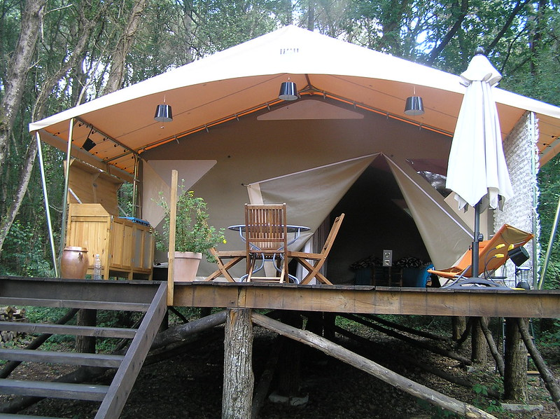 Safari tents are commonly used as Shelter Abodes within glamping spaces, providing spacious environments and adding to facility ambience, and providing historic connection through their association with exploration