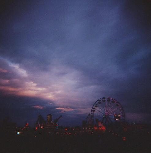 carnival summer sky dark lights evening july slidefilm rides funfair e6 fujiastia100 holga120cfn 2011 chippewafallswisconsin northernwisconsinstatefair