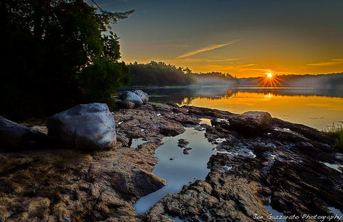 camping vacation sky sun reflection tree nature rock fog sunrise puddle rocks maine yearbook boulder lensflare flare lowtide sunrays week32 hdr starburst nationalgeographic againstthelight cascobay greatphotographers bestofblinkwinners