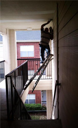 Unsafe ladder in stairwell | by SHP - Safety & Health Practitioner Magazine