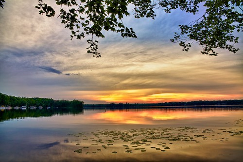 sunset sky lake tree nature water colors clouds shore wi hdr lilypods