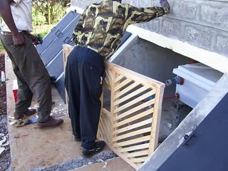 Installing the urine chamber door