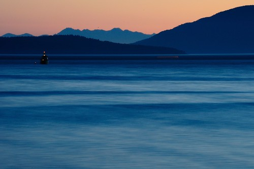ocean blue trees light sunset orange motion mountains water evening boat hills pugetsound olympics olympicmountains sooc