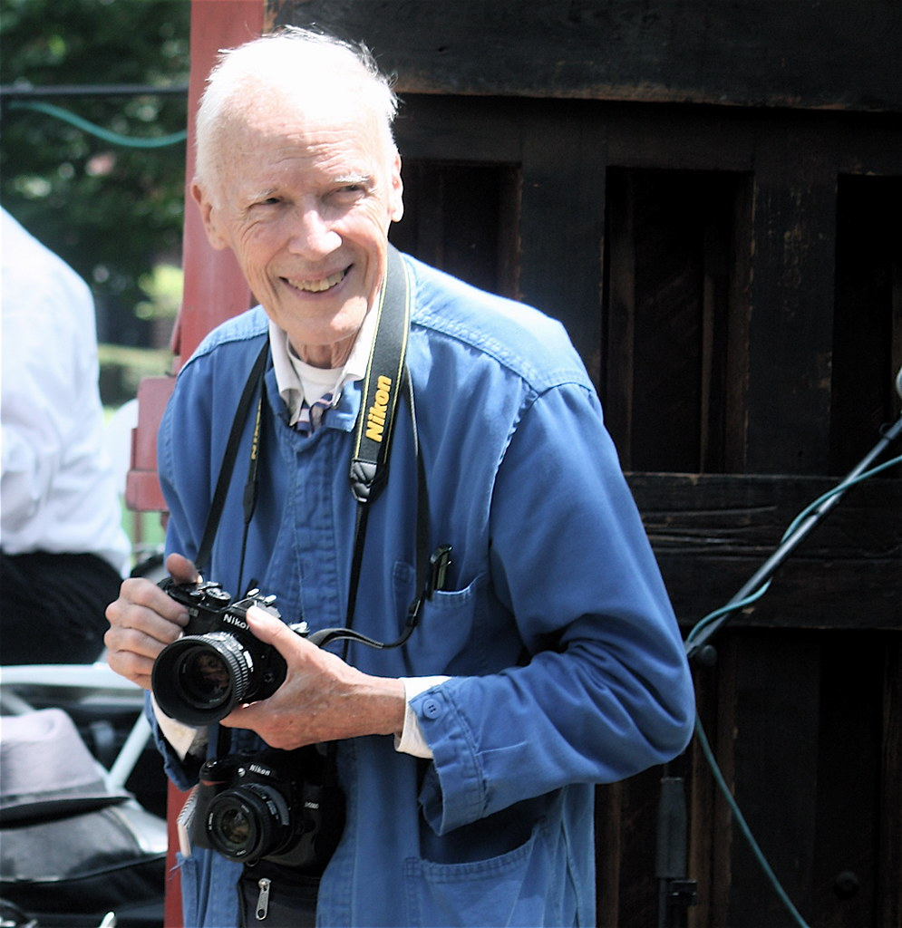 new york city governors island jazz age party bill cunningham smiling holding camera