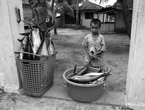 Boy with fish, Pulau Saparua