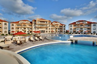 Lounge by the pool at Grand Caribe | by Grand Caribe
