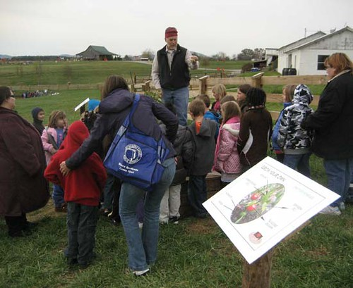 Students learn about photosynthesis and pollination at the Grow Your Own station.