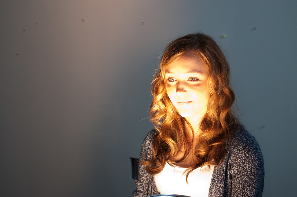 Image of woman with poorly positioned light for video conferencing