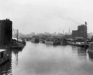Industrial Newtown Creek in Queens toward Manhattan with wooden boats and barges . New York.  1915 | by wavz13