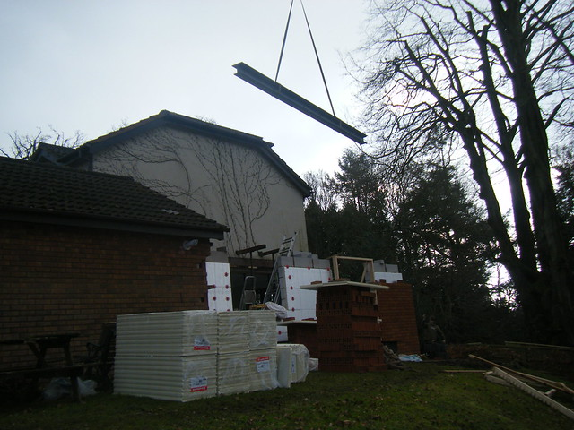 <p>Two storey extension. Cut a seven metre opening to create open plan kitchen and dining area with bedroom above. Installed beam with two upright beams welded to ends to create goal post effect. Laid oak flooring throughout ground floor.</p>