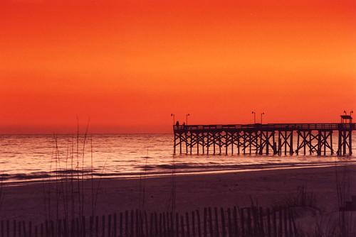ocean sunset red sky orange sun black color beach nature silhouette clouds pier dof florida lyleuga