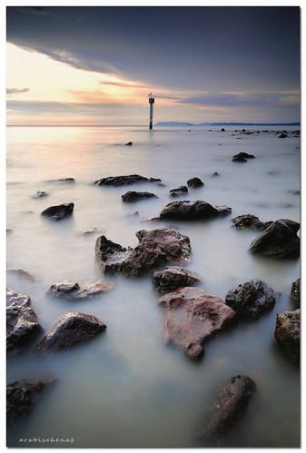 longexposure sunset sea lighthouse seascape beach rock landscape laut malaysia batu pantai schneider pasirpanjang nikkor1835mmf3545difed nikond700 leefilter09soft