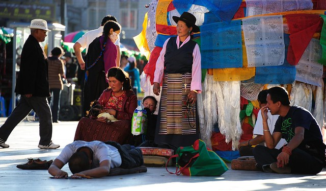 Kelzang Darchen prayer-flag pole and  prostrating pilgrims, Lhasa Tibet