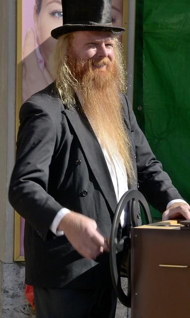 Street organ player