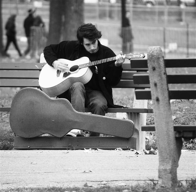 boston common man playing guitar