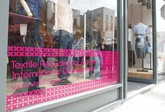 Pink vinyl graphic reverse cut on glass