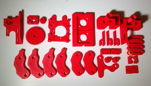 Prusa Mendel parts in fluorescent red abs   by John Biehler