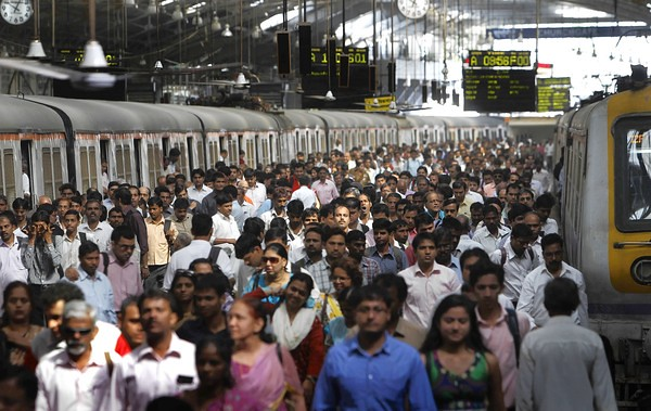 Commuters alight from local suburban trains at a Church gate station in Mumbai, India. Nearly 7 million commuters use the overtaxed suburban rail network each workday in Mumbai.