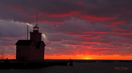 november light sunset red sky orange lake holland water clouds dark pier michigan bigred