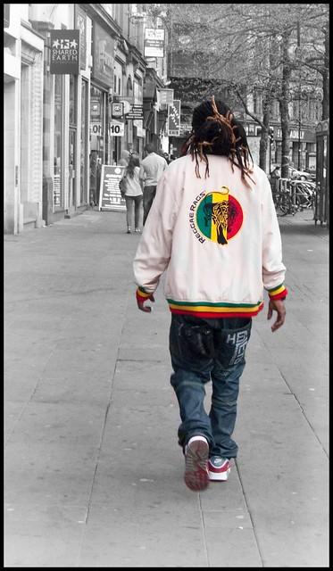 Dreadlocks and a multi-colored Reggae Rags jacket