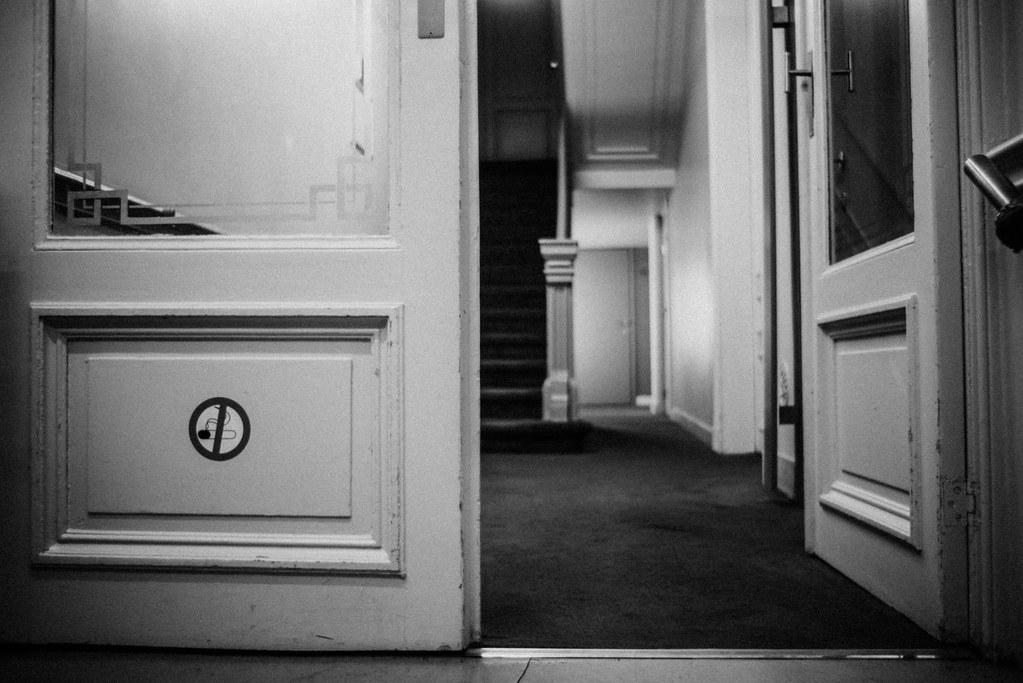 Open the door!   Half-open door in black and white ...