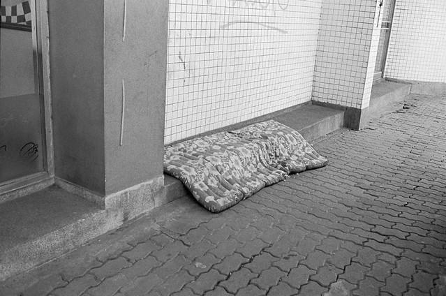 a mattress on footpath