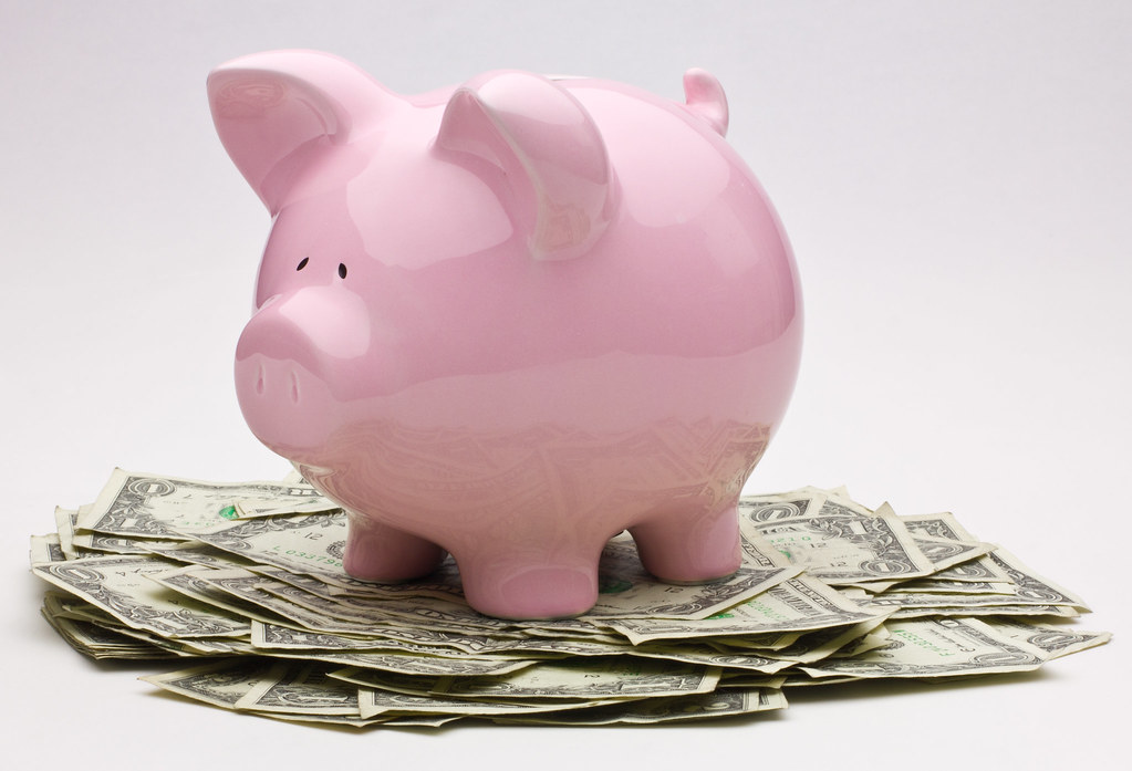Pink Piggy Bank On Top Of A Pile Of One Dollar Bills   Flickr