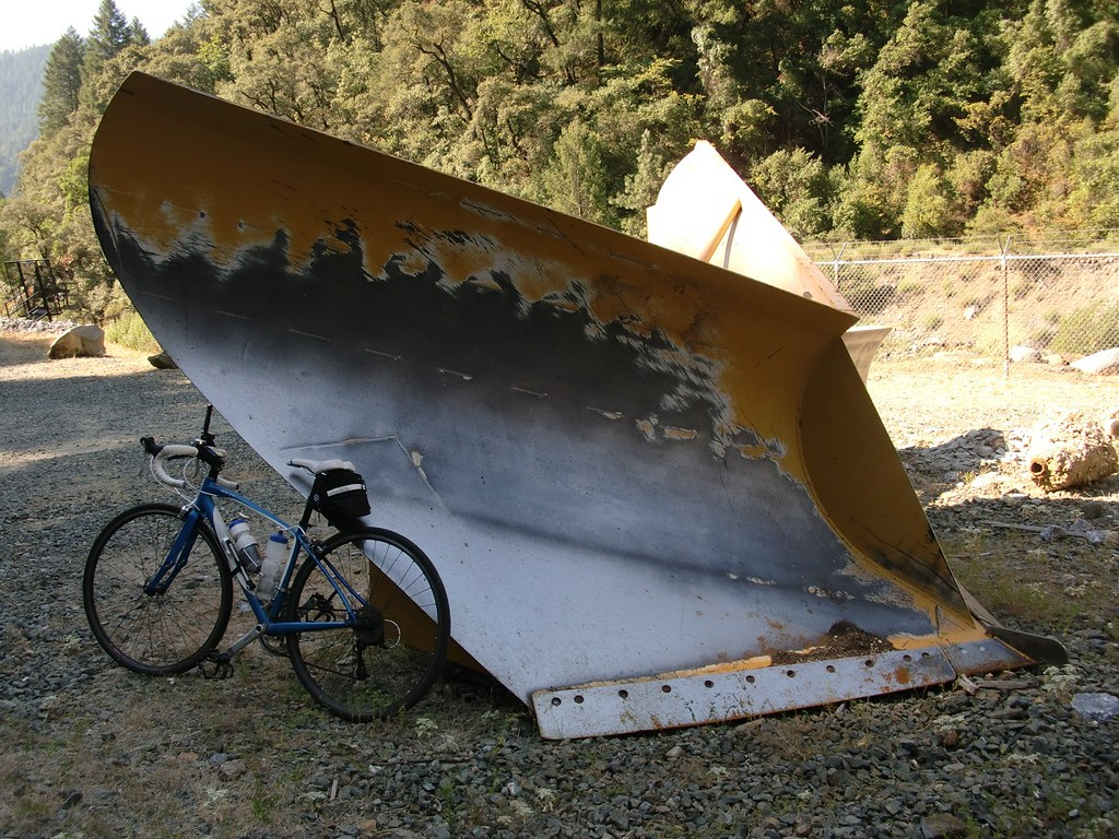 road bike next to giant snowplow   This is next to the Ralst