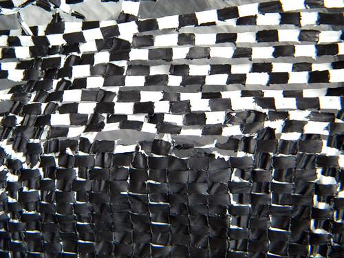 checkerboard of black & white woven plastic wrap