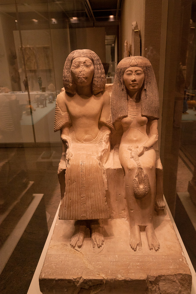 Yuny and His Wife, Renenutet ca. 1290–1270 B.C.E.; early Dynasty 19; late reign of Sety I–early reign of Ramesses II; New Kingdom Egyptian; Asyut Limestone; H. 34 in. (86.4 cm)  The Metropolitan Museum allows photo shooting providing there is no financial gain.  Please respect their policy