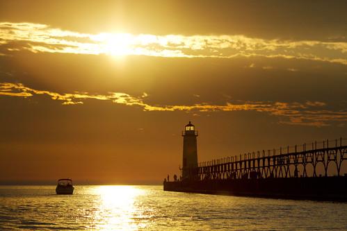 sunset people weather pier boat fishing michigan silhouettes lakemichigan manistee