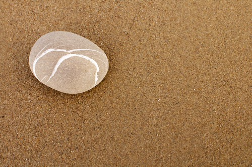 Zen rock on beach sand | by photoloni
