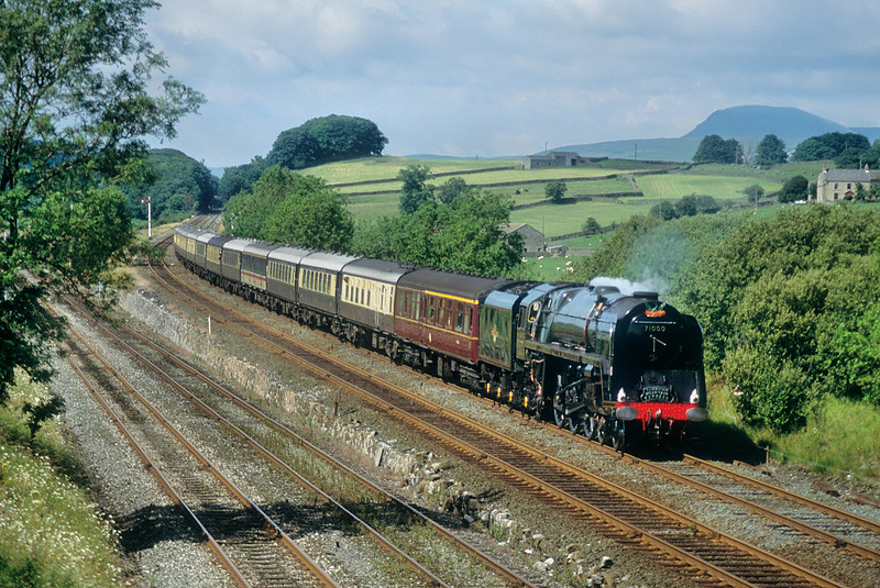 71000 'Duke of Gloucester' coasts past Settle Junction with a southbound Cumbrian Mountain Express on 20th July 1991. At least with minimal exhaust Penyghent is clearly visible.