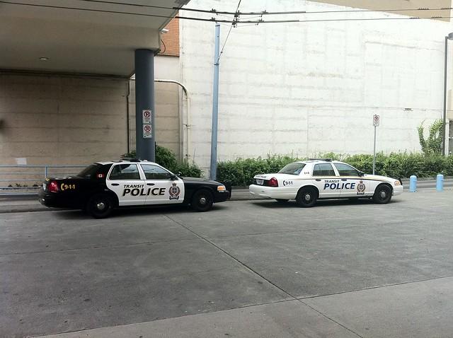 Two transit police vehicles at Metrotown bus loop