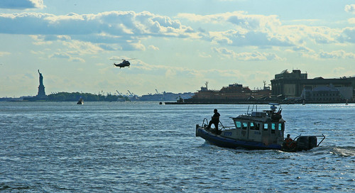 Police Boat, helicopter and Statue of Liberty in the Background