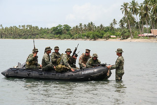 Members of an Armed Forces of the Philippines Marine battalion landing team and a US Navy Sailor depart for a man overboard drill | by Official U.S. Navy Imagery