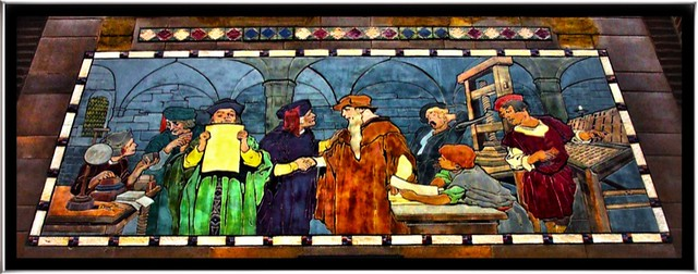 """Franklin Building ~ """"The First Impression"""" depicts men working at the Gutenberg press."""