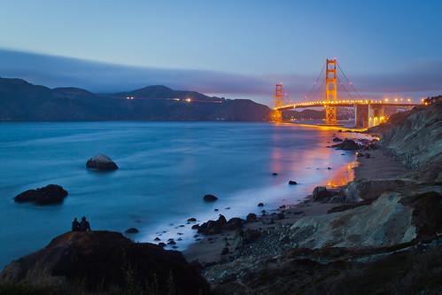 sf sanfrancisco california ca bridge blue sunset red night twilight couple rocks surf azure goldengatebridge goldengate ggb