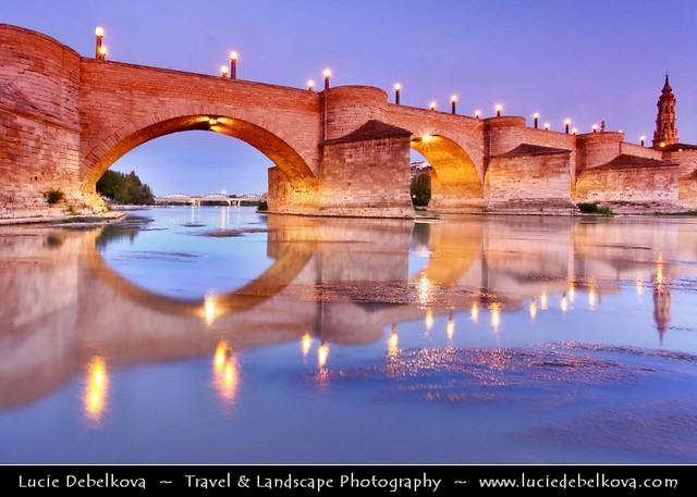 Spain - Aragon - Zaragoza - Puente de Piedra - Stone Bridge over Ebro River lit at Twilight - Dusk - Blue Hour - Night