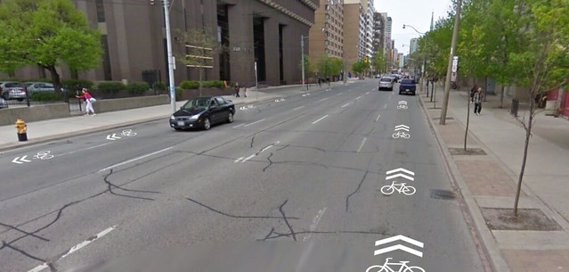 Thu, 07/14/2011 - 10:48 - This is a fictional future. The image is from Google Streetview which is out of date - Jarvis currently has bike lanes. City Council just voted to remove them (jerks!) so we may see some day soon again a 5 car lane highway on this urban street.</p> <p>So if we're stuck with politicians idiocy at the least we can get sharrows on this awful street.