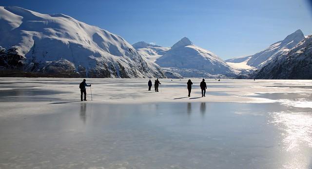 Adventurers on the way to Portage Glacier over a frozen Portage Lake