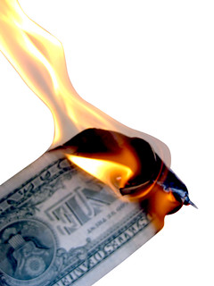 Burning Money Isolated on White | by Images_of_Money