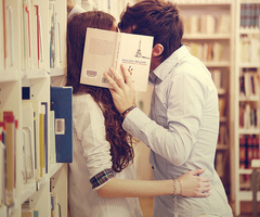 Image result for kissing behind book