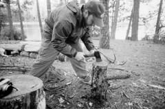 Nolan hatchets the wood