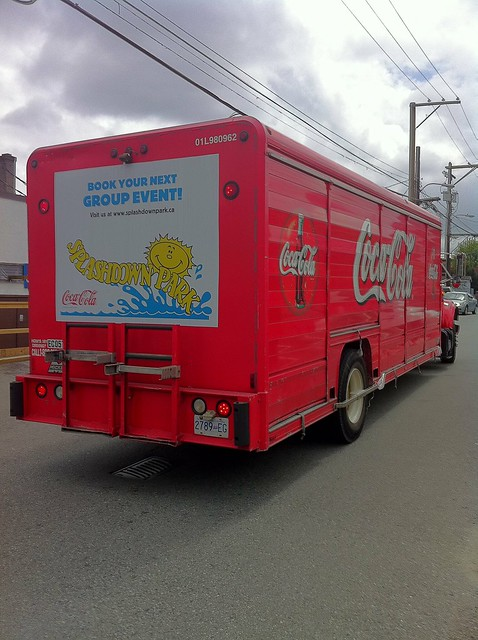 Coca-Cola delivery truck near Main St. (with Splashdown Park ad on the back)