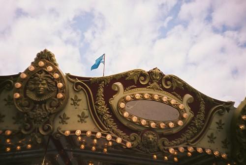 summer sky film clouds analog 35mm flag july carousel lomolca 2011 fujireala100 chippewafallswisconsin northernwisconsinstatefair