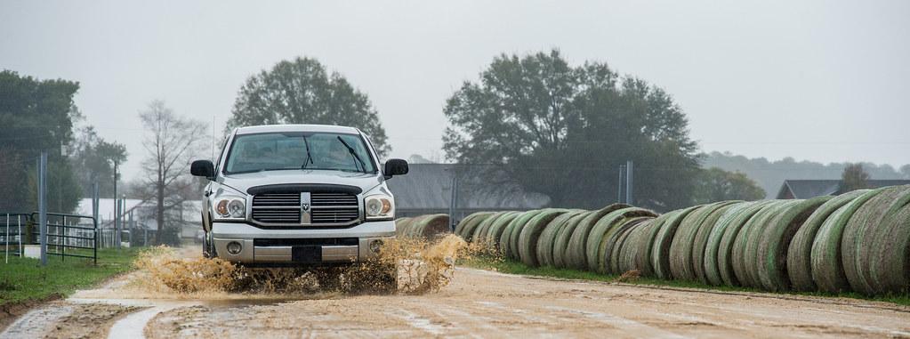 20151110-RD-LSC-0069 | A pick-up truck splashes along a mudd
