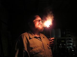 MAN lights his cigar